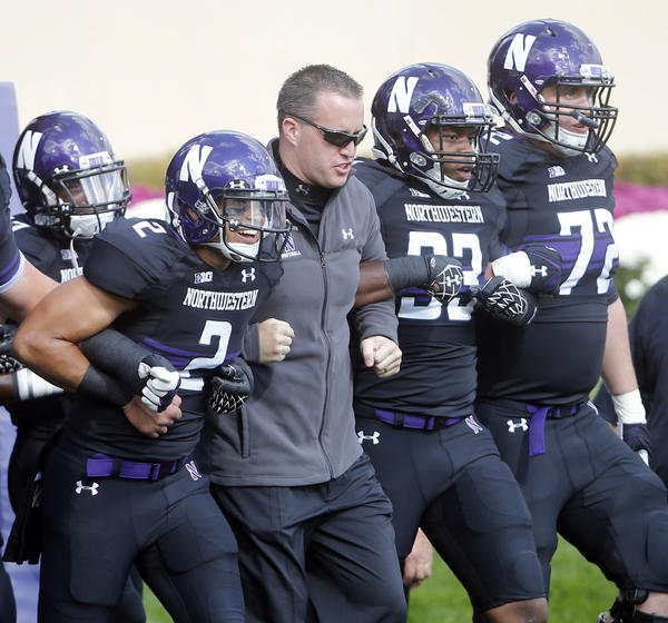 Northwestern Wildcats head coach Pat Fitzgerald takes the field with his team on October 20, 2012, in Evanston.