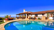 Set in a gated community atop the Palos Verdes Peninsula and designed for entertaining, this Spanish-style estate takes in coastline and city views. The nearly five acres of grounds include a courtyard, a putting/chipping green, a sports/basketball court, a swimming pool and two spas.