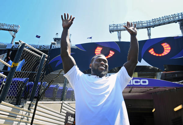 Baltimore Ravens' 2013 NFL first round pick Matt Elam is introduced to fans gathered at M&T Bank Stadium for the Ravens Spring Football Festival.