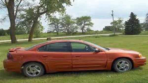 This is a photo of a vehicle similar to the 2002-2004 Pontiac Grand Am involved in a hit-and-run accident in the Lawndale neighborhood this morning.