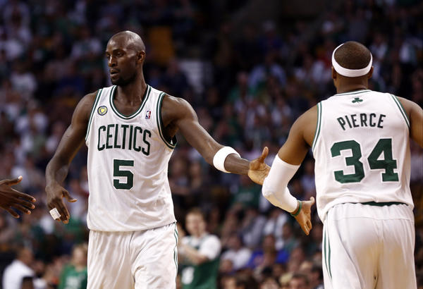 Boston Celtics center Kevin Garnett (5) and small forward Paul Pierce (34) celebrate against the New York Knicks on Sunday.
