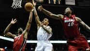 Bucks guard Monta Ellis draws defensive attention Sunday from the Heat's Chris Bosh (left) and Udonis Haslem. (Benny Sieu, USA Today Sports)