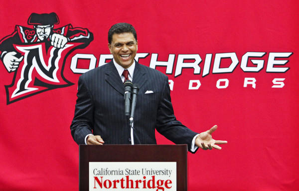 Reggie Theus was all smiles at his news conference announcing the former NBA star as coach at Cal State Northridge.