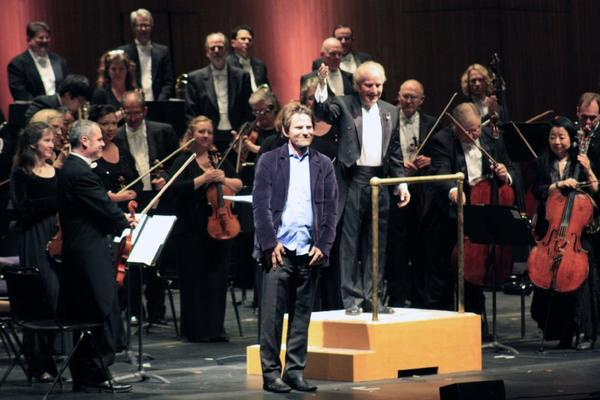 "Composer Steven Mackey takes a bow after the Long Beach Symphony Orchestra performs the World Premiere of his piece ""Urban Ocean"" on April 27, 2013 at the Terrace Theater in Long Beach."