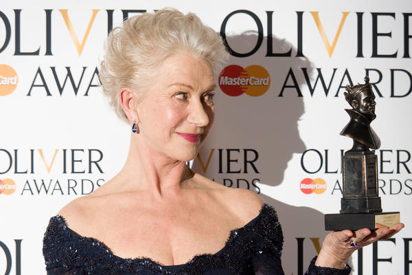 British actress Helen Mirren poses with her award for best actress during the Lawrence Olivier Awards for theatre at the Royal Opera House in London.