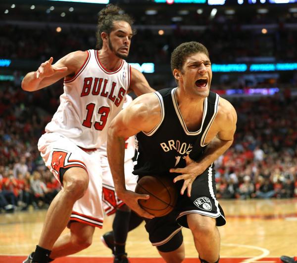 Bulls center Joakim Noah battles Nets center Brook Lopez.