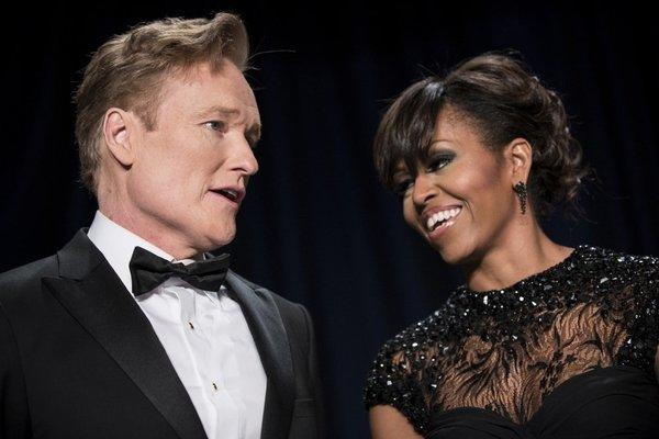 TV host Conan O'Brien and First Lady Michelle Obama speak during the White House Correspondents' Association Dinner on April 27, 2013, in Washington, D.C. Obama attended the yearly dinner attended by journalists, celebrities and politicians.