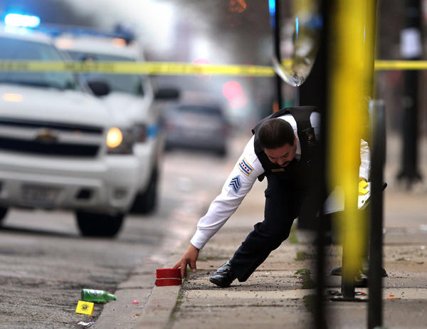 Chicago Police work the scene of a shooting in the 2500 block of West Division Street in Chicago on Sunday.