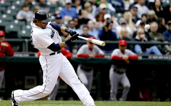 Seattle Mariners' Michael Morse hits a home run against the Angels in the eighth inning.