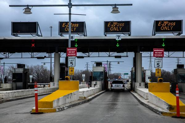 Cars are going through the I-Pass/ E-ZPass toll-collection lanes on the Indiana Toll Road in Hammond on April 19. Illinois Tollway I-Pass customers are charged an extra 3 cents each time they pay a toll on the Chicago Skyway or the Indiana Toll Road.
