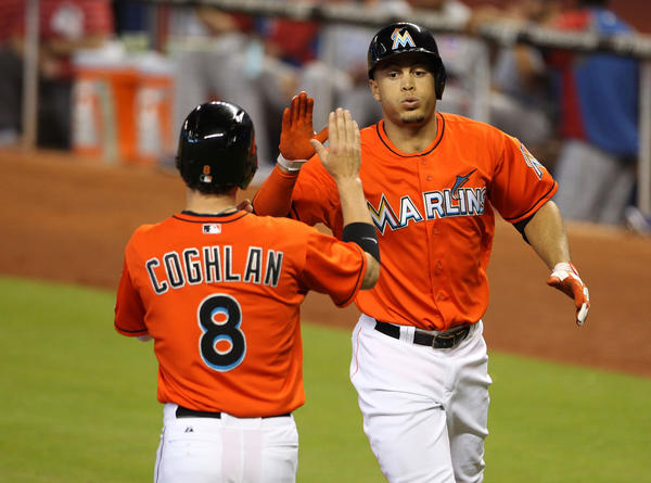 MIAMI, FL - APRIL 28: Giancarlo Stanton #27 of the Miami Marlins celebrates a two run home run against the Chicago Cubs with teammate Chris Coghlan #8 at Marlins Park on April 28, 2013 in Miami, Florida. (Photo by Marc Serota/Getty Images) ORG XMIT: 163493340