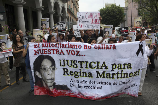 Journalists march in Veracruz, Mexico, on Sunday, the anniversary of the death of journalist Regina Martinez. Others marched in other state capitals to protest violence against members of the news media.