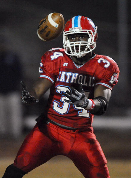 Charlotte Catholic running back Elijah Hood keeps his eyes on the ball as he prepares to field a kick during first quarter action vs A.L. Brown on Friday, Nov. 16, 2012 at Charlotte Catholic in Charlotte, N.C.