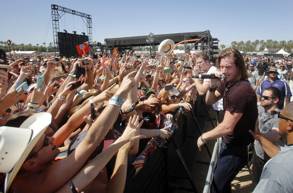 Florida Georgia Line members Brian Kelley, left with microphone, and Tyler Hubbard on Sunday at the Stagecoach Country Music Festival in Indio.