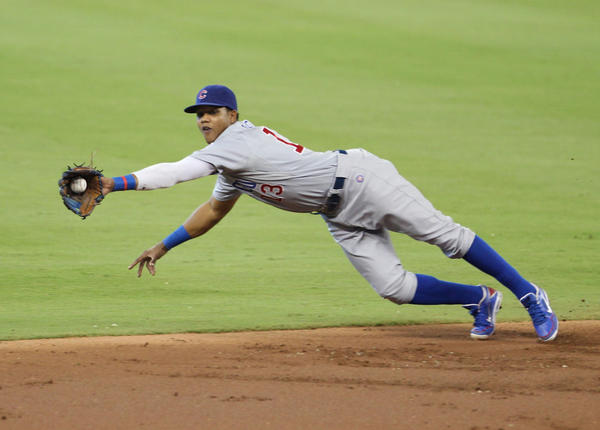 Cubs shortstop Starlin Castro makes a diving catch Sunday.