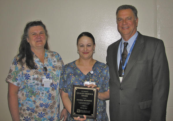 Michelle Richmond, center, City Hospitals February Quality Service Award winner, is pictured with Brenda McDaniel, environmental services manager, left, and Anthony Zelenka, chief administrative officer.