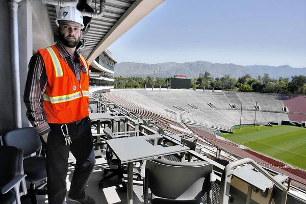 George Cunningham, Rose Bowl Operating Co. chief operating officer, sees the progress of some of the loge boxes at the Rose Bowl. A television will be installed in each table soon.
