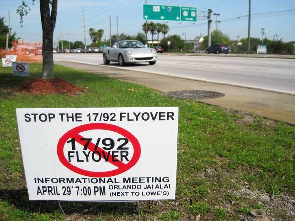 "A ""Stop the 17-92 Flyover"" sign on State Road 436 in Casselbery advertsises a meeting at the Orlando Jai-Alai on Monday at 7 p.m.. Several business owners near the intersection of U.S. Highway 17-92 and 436 are opposed to a ""flyover"" project scheduled to begin construction later this year."