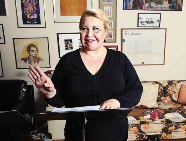 "Honey West, star and co-author of ""Genderella,"" a new musical running this week, rehearses at the home of co-author Joanne Koch."
