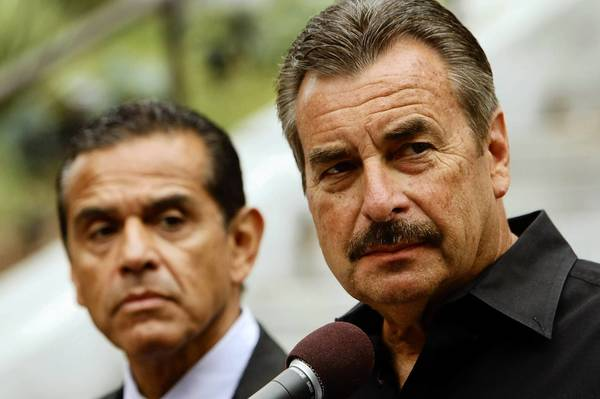 Los Angeles Police Chief Charlie Beck, right, at a recent news conference with Mayor Antonio Villaraigosa, has pledged in the wake of ex-cop Christopher Dorner's rampage to re-examine the cases of other former officers who felt they had been wrongly expelled from the force.