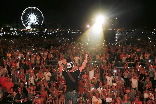 """Dierks Bentley performs the song """"Home"""" as the crowd participates by holding up its lighted-up cellphones on the Mane Stage on the second day of the Stagecoach Country Music Festival at the Empire Polo Club in Indio, on April 27, 2013."""