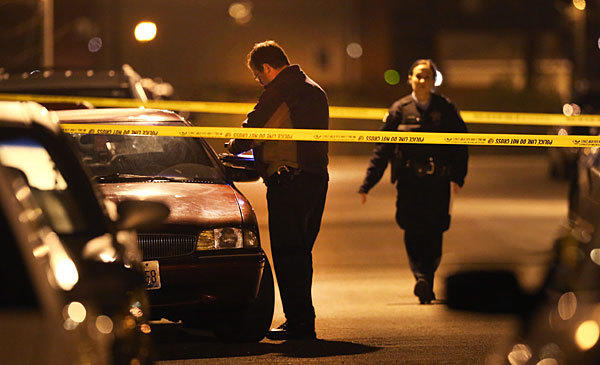 Chicago Police search for evidence in the the 300 block of South Maplewood Avenue near one of the involved vehicles.