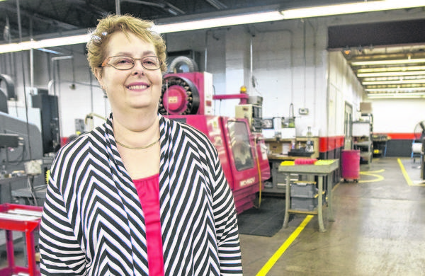 Pam Rubenstein stands on the plant floor at Allied Specialty Precision Inc. in Mishawaka. Rubenstein owns the aerospace components manufacturer.