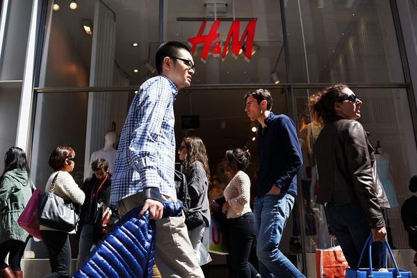 Shoppers walk along Broadway in New York.