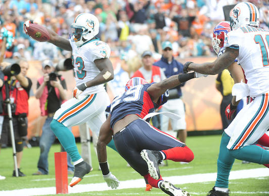 Ricky Williams of the Miami Dolphins runs in for a touchdown in the second quarter.
