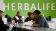 Los Angeles nutritional products company Herbalife Ltd. reported $1.1 billion in first-quarter sales and profit that soundly beat analysts' expectations and its own guidance.