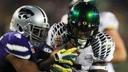 As the second round of the 2013 NFL draft wound down Friday night, the Ravens traded a pair of draft picks to the Seattle Seahawks in order to move up six spots and draft Kansas State inside linebacker Arthur Brown.
