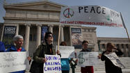 About a dozen anti-war activists protested Boeing's annual meeting at the Field Museum of Natural History on Monday, arguing against the world's largest plane maker's production of drones and its financial support by the city of Chicago.