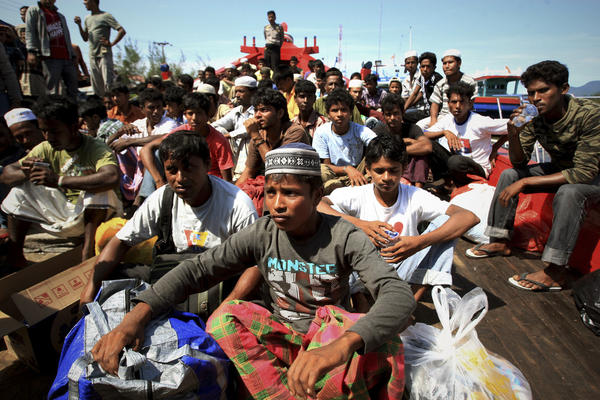 Rescued Rohingya migrants from Myanmar wait at a port in Aceh, Indonesia, after their boat was hobbled in a storm.