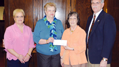 Somerset Calvary United Methodist Church donated $600 to the Somerset Community Clinic from proceeds made through a ham loaf sale. Making the presentation from left, are: Judy Harvey and Sandy Hagy, ham loaf committee members, Lois Lafferty of the clinic, and the Rev. Arnie McFarland, pastor of the church.