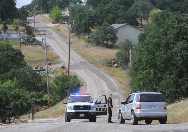 A Calaveras County sheriff's deputy detains a driver Sunday on Rippon Road in Valley Springs, Calif., where 8-year-old Leila Fowler was found murdered the evening before.