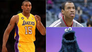 Metta World Peace wore a blue Cookie Monster T-shirt for his end-of-season meeting with Lakers General Manager Mitch Kupchak and Coach Mike D'Antoni on Monday.