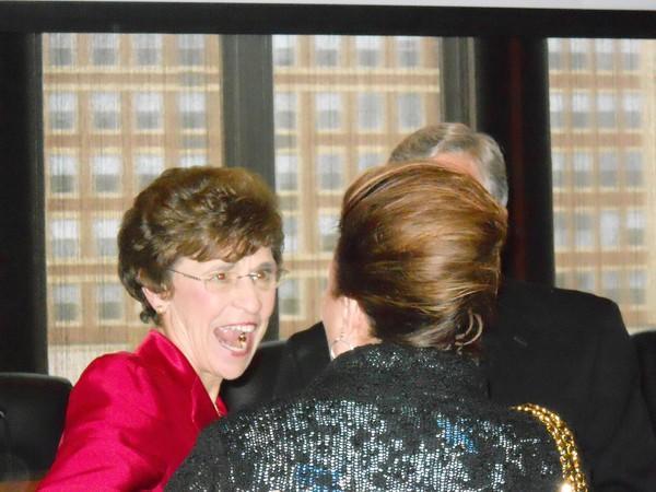 Retiring Arlington Heights Mayor Arlene Mulder greets former Palatine Village President Rita Mullins.