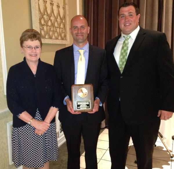 Northwest Catholic girls' soccer coach Todd Sadler, center, has been named the Doc McInerney High School Girls' Coach of the Year by the Connecticut Sports Writers' Alliance. He is pictured with Northwest Principal Margaret Williamson and Athletic Director Matthew Marterelli.