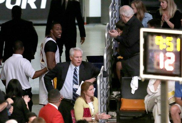Lakers center Dwight Howard has a few words for General Manager Mitch Kupchak in the tunnel as he leaves the court after his ejection in the third quarter of Game 4 on Sunday at Staples Center.