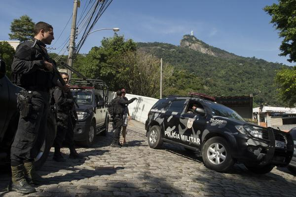 Military police forces carry out an operation at Guararapes slum in Rio de Janeiro. A Brazilian government crackdown on crime is being credited with lowering demand for bulletproof cars among the wealthy in Rio.