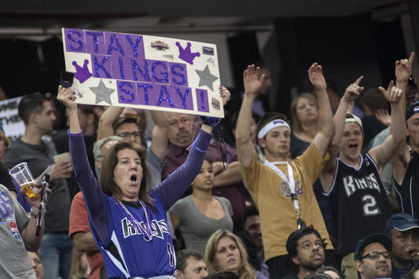 Sacramento Kings fans hold up a sign during the game against the Los Angeles Clippers at the Sleep Train Arena.