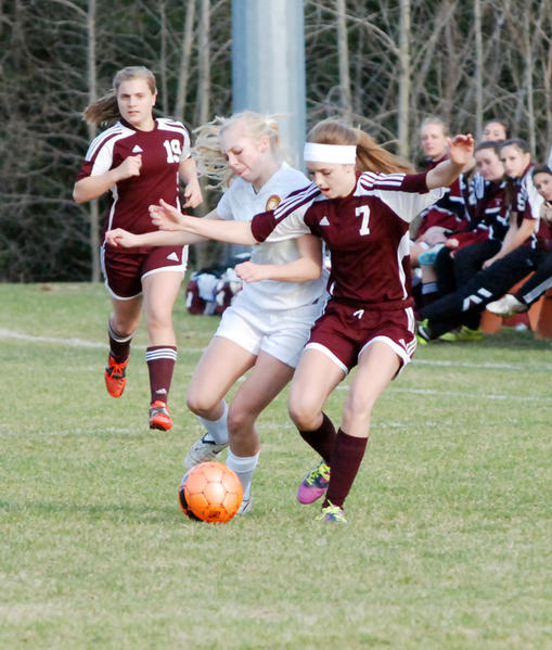 Harbor Springs junior Betsey Simons (left) and Charlevoix freshman Kelsey Engstrom battle for possession of the ball Friday at Ottawa Stadium in a Lake Michigan Conference match. The Rams defeated the Rayders, 3-1.
