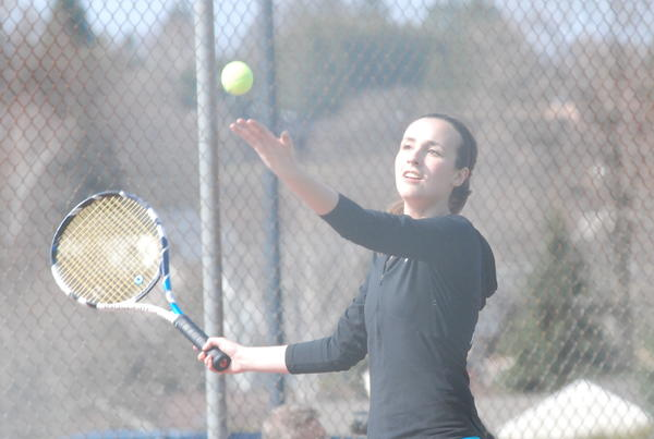 Petoskey's Amelia Farr serves during a No. 4 doubles match against Essexville Garber Saturday at the Petoskey Quad tournament at the Petoskey High School tennis courts. The Northmen won the tournament title, taking seven of eight flights.