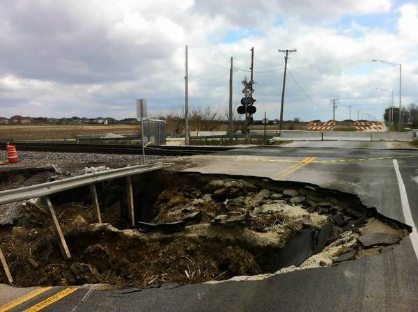 A massive hole in the road caused by flooding just north of incorporated Plainfield on 111th Street.