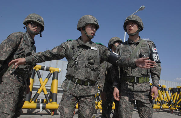South Korean soldiers stand at a military check point connecting South and North Korea at the Unification Bridge in Paju, South Korea.