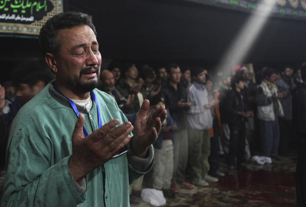 A man prays in a mosque in Kabul, Afghanistan.