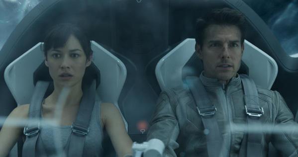 """Julia (Olga Kurlyenko) and Jack (Tim Cruise) hurtle through the air in the Bubbleship in the movie """"Oblivion."""""""