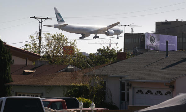 The view from Kittyhawk Avenue in Westchester as an airliner comes in for a landing on the north runway at Los Angeles International Airport.