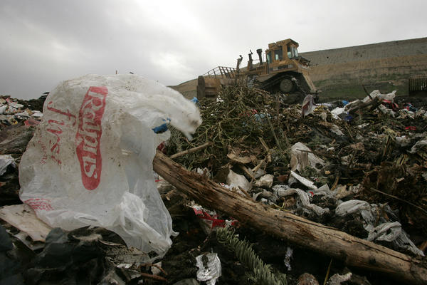 A plastic shopping bag from Ralph's supermarket on the ground at the Calabasas landfill.