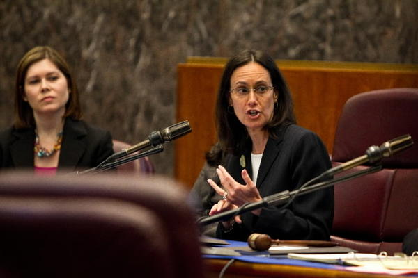 Illinois Attorney General Lisa Madigan, center, addresses the Council Housing & Real Estate Committee hearing held by 31st Ward Alderman Ray Suarez, right, Chairman of the Council Housing & Real Estate Committee on Wednesday, June 13, 2012. The meeting held in the Council Chambers is related to the recent historic $25 billion National Mortgage Foreclosure Settlement, negotiated by a collaboration of Attorney General offices across the United States.